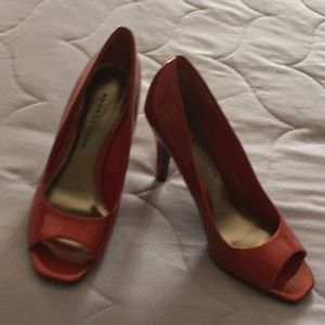 Red Heels Size 6.5. Never worn by apostrophe.